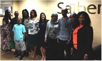 Saiber Counsel Geri Albin accompanies a family of new homeowners after the closing of their new home at Saiber's Newark office.
